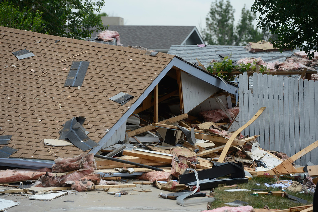 . Debris is scattered at the after the house explosion on Ingalls Street in Westminster.  (Photo By Andy Cross/The Denver Post)