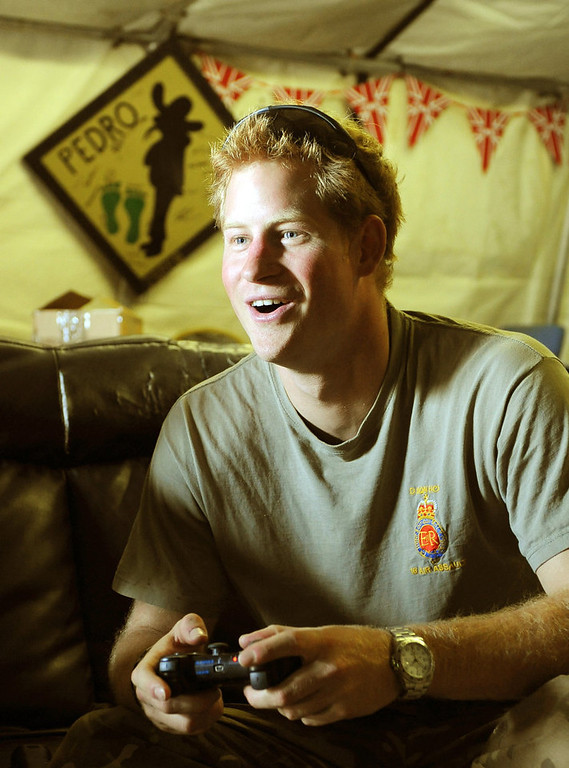. This picture taken on November 3, 2012 shows Britain\'s Prince Harry (R) playing computer games in the VHR (very high ready-ness) at the British controlled flight-line at Camp Bastion in Afghanistan\'s Helmand Province, where he was serving as an Apache Helicopter Pilot/Gunner with 662 Sqd Army Air Corps. Britain\'s Prince Harry confirmed he killed Taliban fighters during his stint as a helicopter gunner in Afghanistan, it can be reported after he completed his tour of duty on January 21, 2013. JOHN STILLWELL/AFP/Getty Images