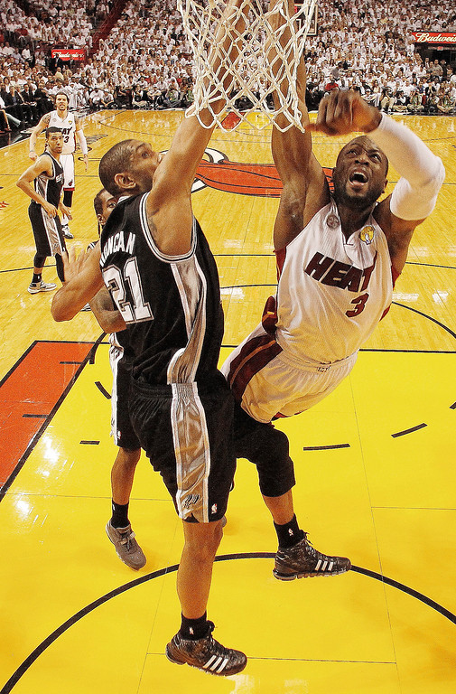 . Miami Heat shooting guard Dwyane Wade (3) shoots against San Antonio Spurs power forward Tim Duncan (21) during the first half of Game 6 in the NBA Finals basketball game,  Tuesday, June 18, 2013 in Miami. (AP Photo/Mike Segar, Pool)