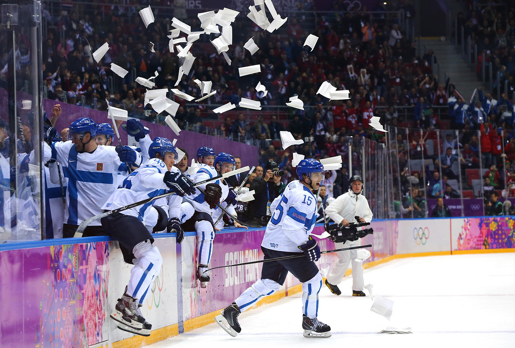 . SOCHI, RUSSIA - FEBRUARY 22: Sami Vatanen #45 and Tuomo Ruutu #15 of Finland celebrate with teammates after defeating the United States 5-0 during the Men\'s Ice Hockey Bronze Medal Game on Day 15 of the 2014 Sochi Winter Olympics at Bolshoy Ice Dome on February 22, 2014 in Sochi, Russia.  (Photo by Martin Rose/Getty Images)