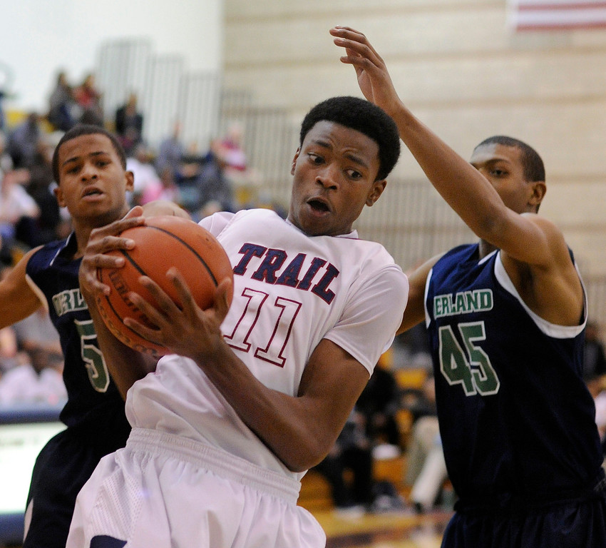 . Trailblazers forward Andrew Tillman (11) grabbed a rebound in the first half. The Cherokee Trail boy\'s basketball team defeated Overland 59-57 Friday night, January 11, 2013. Karl Gehring/The Denver Post
