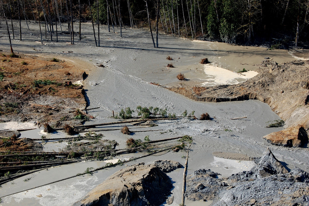 . In this handout from Washington State Dept of Transportation, an aerial view of a breach where water from the Stillaguamish River begins to move through the dam created March 23, 2014 between Darrington and Arlington, Washington. (Photo by Washington State Dept of Transportation via Getty Images)
