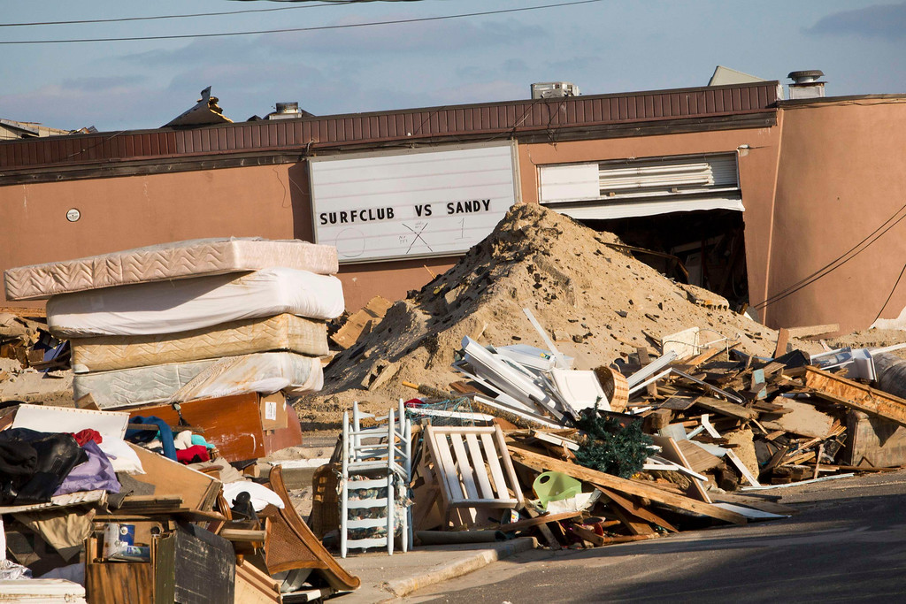 . Garbage from homes destroyed by Hurricane Sandy is piled high along a sidewalk in the Ortley Beach area of Toms River, New Jersey November 28, 2012. The storm made landfall along the New Jersey coastline on October 29, 2012 - one month ago tomorrow. REUTERS/Andrew Burton