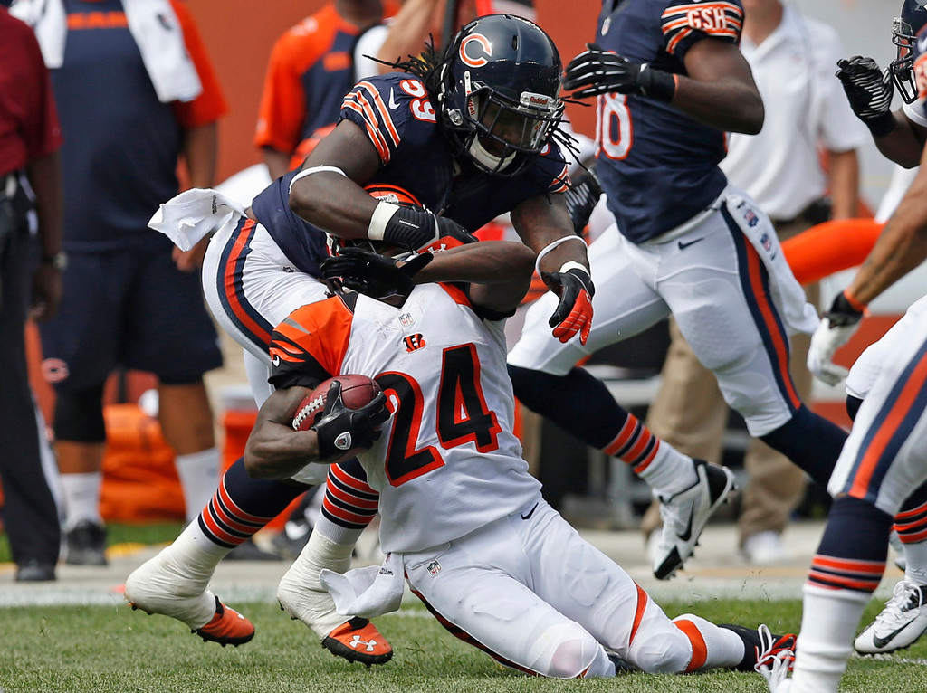 . Chicago Bears outside linebacker Khaseem Greene (59) tackles Cincinnati Bengals cornerback Adam Jones (24) during the first half of an NFL football game, Sunday, Sept. 8, 2013, in Chicago. The play was called back on a Bengals penalty. (AP Photo/Charles Rex Arbogast)