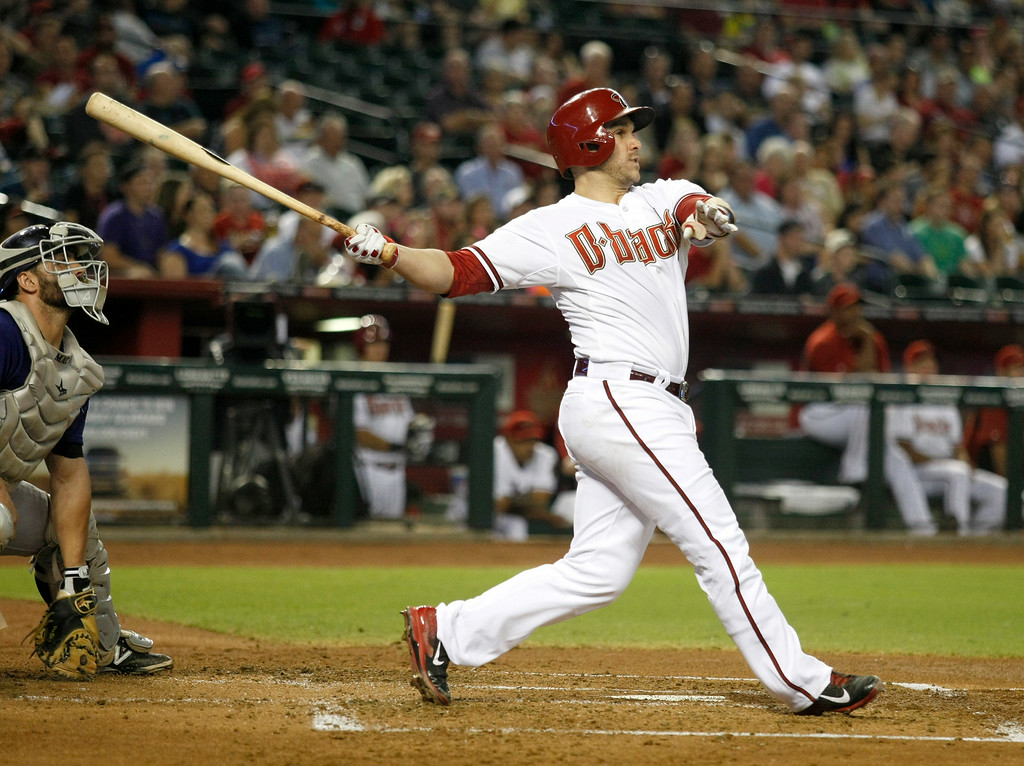 . Arizona Diamondbacks\' Miguel Montero (26) follows through on a three-run home run in the first inning during a baseball game against the Colorado Rockies, Friday, Aug. 8, 2014, in Phoenix. (AP Photo/Rick Scuteri)