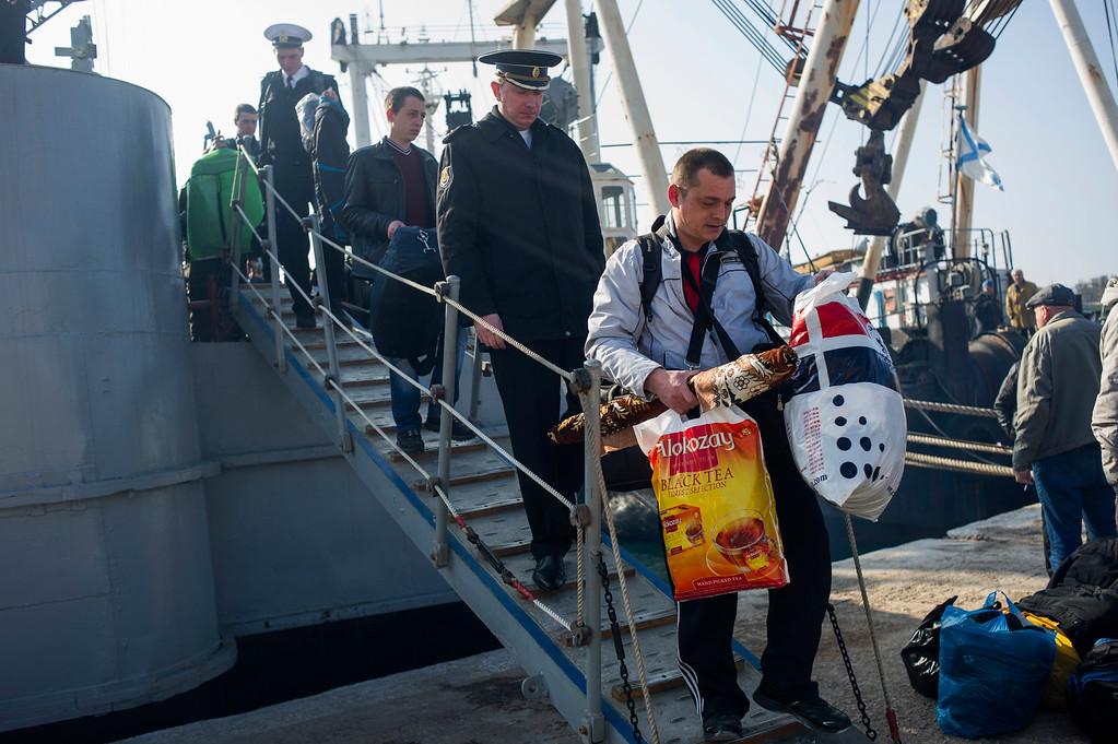 . Crew members of  the Ukrainian corvette Khmelnitsky leave their ship which has been seized by pro-Russian forces in Sevastopol, Crimea, Thursday, March 20, 2014. (AP Photo/Andrew Lubimov)