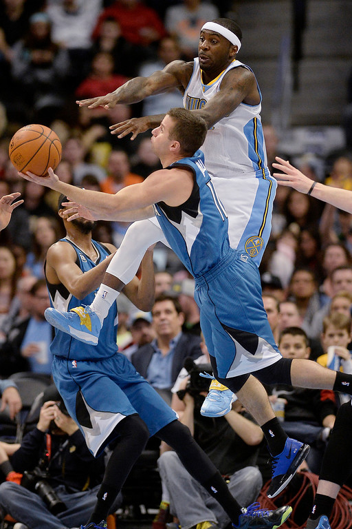 . Ty Lawson (3) of the Denver Nuggets defends J.J. Barea (11) of the Minnesota Timberwolves during the first quarter at the Pepsi Center.  (Photo By AAron Ontiveroz/The Denver Post)