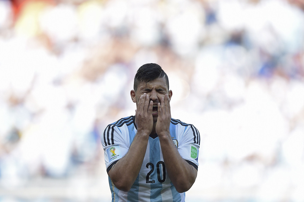 . Argentina\'s forward Sergio Aguero reacts after missing a shot during the Group F football match between Argentina and Iran at the Mineirao Stadium in Belo Horizonte during the 2014 FIFA World Cup in Brazil on June 21, 2014. JUAN MABROMATA/AFP/Getty Images