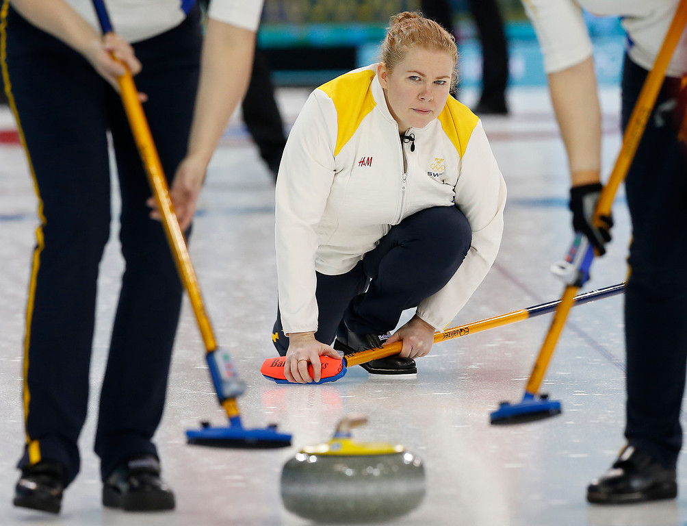 . Sweden\'s skip Margaretha Sigfridsson, watches the rock during the women\'s curling competition against Switzerland at the 2014 Winter Olympics, Thursday, Feb. 13, 2014, in Sochi, Russia. (AP Photo/Wong Maye-E)