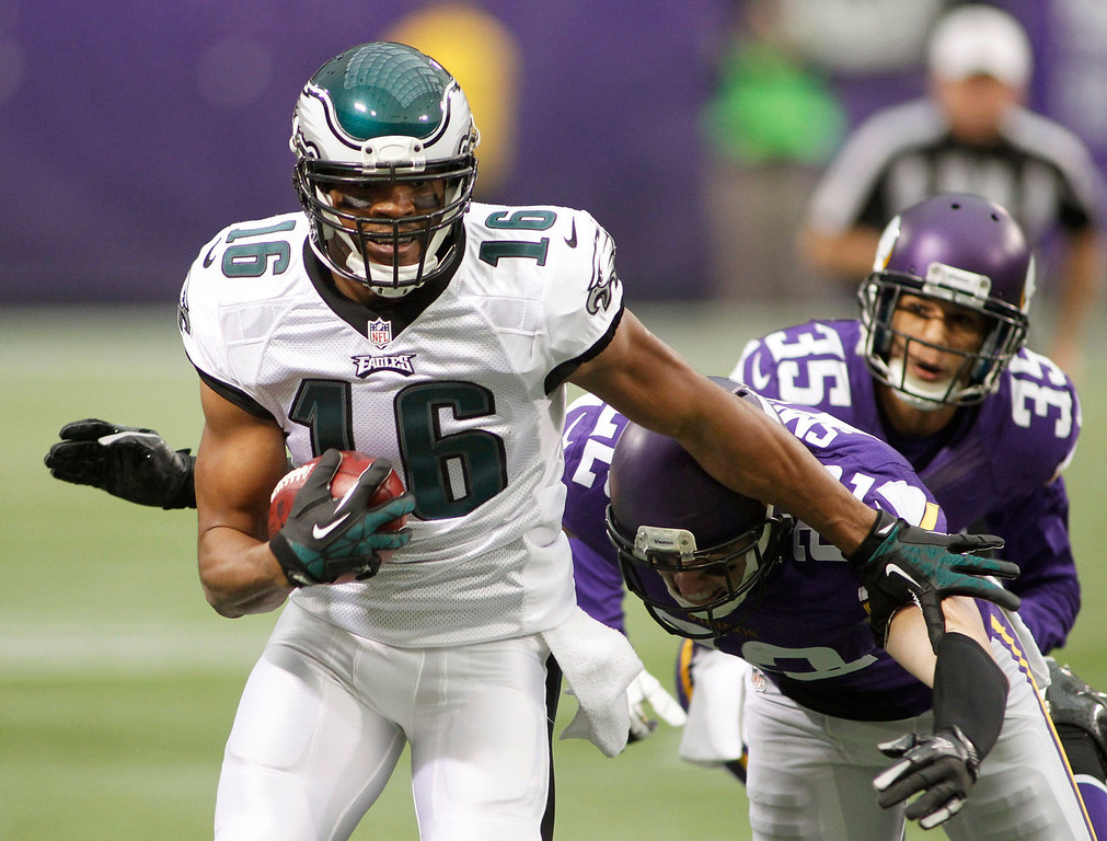 . Philadelphia Eagles wide receiver Brad Smith (16) runs from Minnesota Vikings defenders Harrison Smith (22) and Marcus Sherels (35) after making a reception during the first half of an NFL football game, Sunday, Dec. 15, 2013, in Minneapolis. (AP Photo/Andy King)