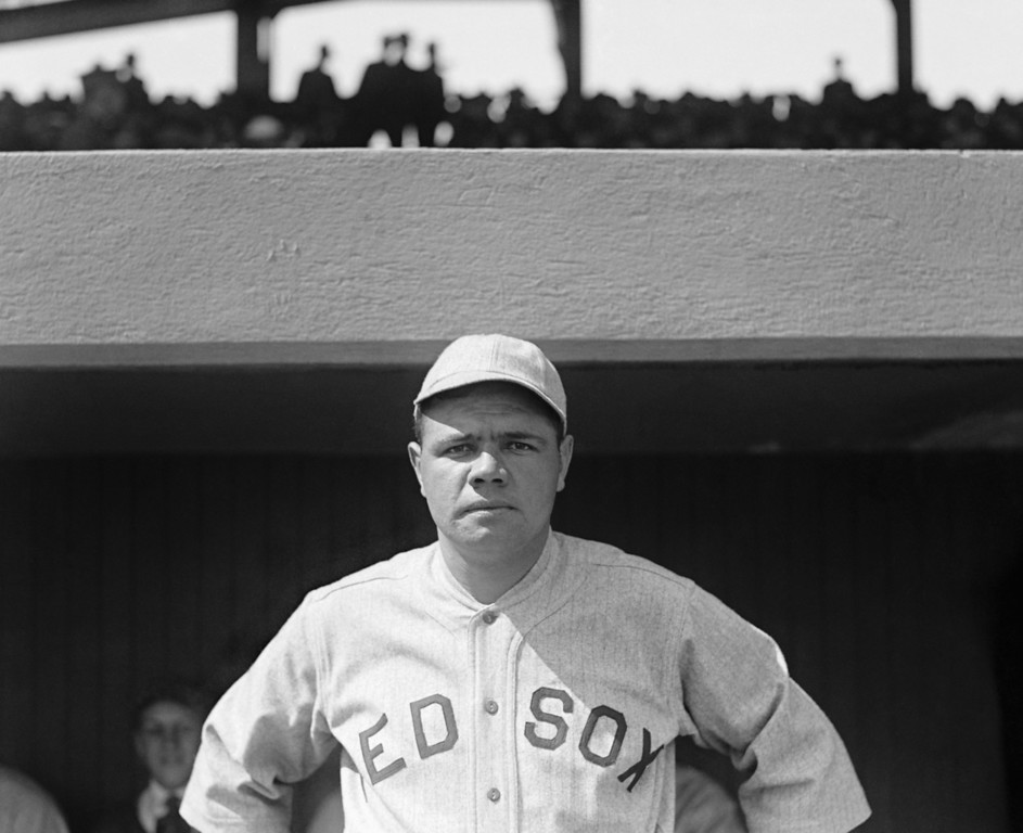 . Babe Ruth poses in 1919, his last season in a Boston Red Sox uniform. The Babe went 89-46 as a pitcher in his six seasons with Boston, and he was 3-0 with a 0.87 ERA in three World Series starts. He might well have become a Hall of Fame pitcher. But in 1919, playing much of the season in the outfield, he hit .322 with 29 home runs, more than hinting at the greatness to come. Of course, along with the heroics came salary demands and flashes of Ruth\'s reckless behavior, which may have contributed to Boston\'s willingness to part with its star. Whatever the reason, by year\'s end the Babe would be a New York Yankee. (AP Photo/Library of Congress)