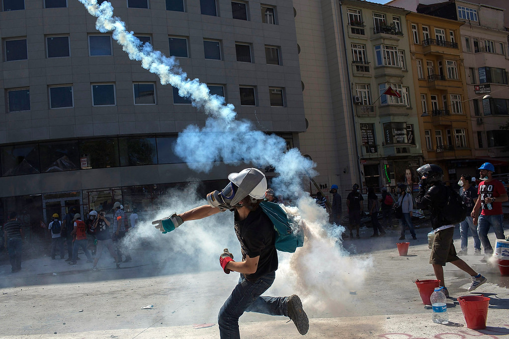 . Protesters clash with riot police during a demonstration near Taksim Square on June 11, 2013 in Istanbul, Turkey.   (Photo by Lam Yik Fei/Getty Images)