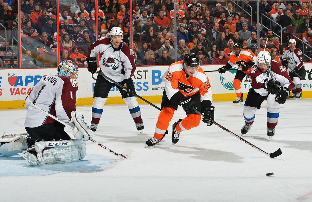 . PHILADELPHIA, PA - FEBRUARY 06: Vincent Lecavalier #40 of the Philadelphia Flyers tries to get a shot off on Semyon Varlamov #1 of the Colorado Avalanche as Jan Hejda #8 and Nate Guenin #5 defend at the Wells Fargo Center on February 6, 2014 in Philadelphia, Pennsylvania.  (Photo by Drew Hallowell/Getty Images)