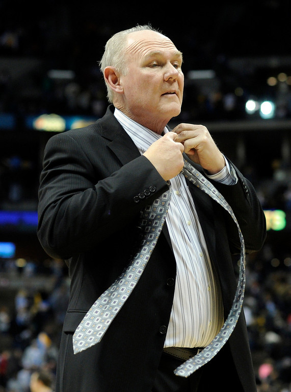 . DENVER, CO - JANUARY 18: Denver coach George Karl wasted no time as he whipped off his tie as he left the court Friday night. The Washington Wizards defeated the Denver Nuggets 112-108 at the Pepsi Center Friday night, January 18, 2013. Karl Gehring/The Denver Post