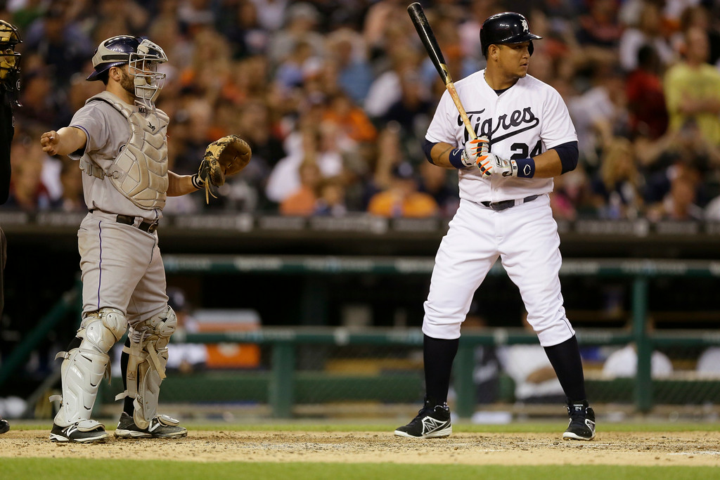. Colorado Rockies catcher Michael McKenry signals for a base on balls to Detroit Tigers\' Miguel Cabrera during the fifth inning of an interleague baseball game, Saturday, Aug. 2, 2014, in Detroit. (AP Photo/Carlos Osorio)
