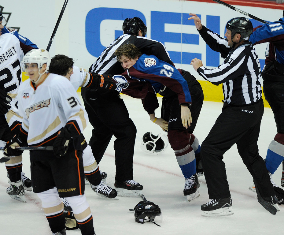 . DENVER, CO. - OCTOBER 02: An official tried to separate Avalanche center Nathan MacKinnon (29) from Anaheim defenseman Ben Lovejoy (6) in the second period. The Colorado Avalanche hosted the Anaheim Ducks at the Pepsi Center Wednesday night, October 2, 2013. Photo By Karl Gehring/The Denver Post