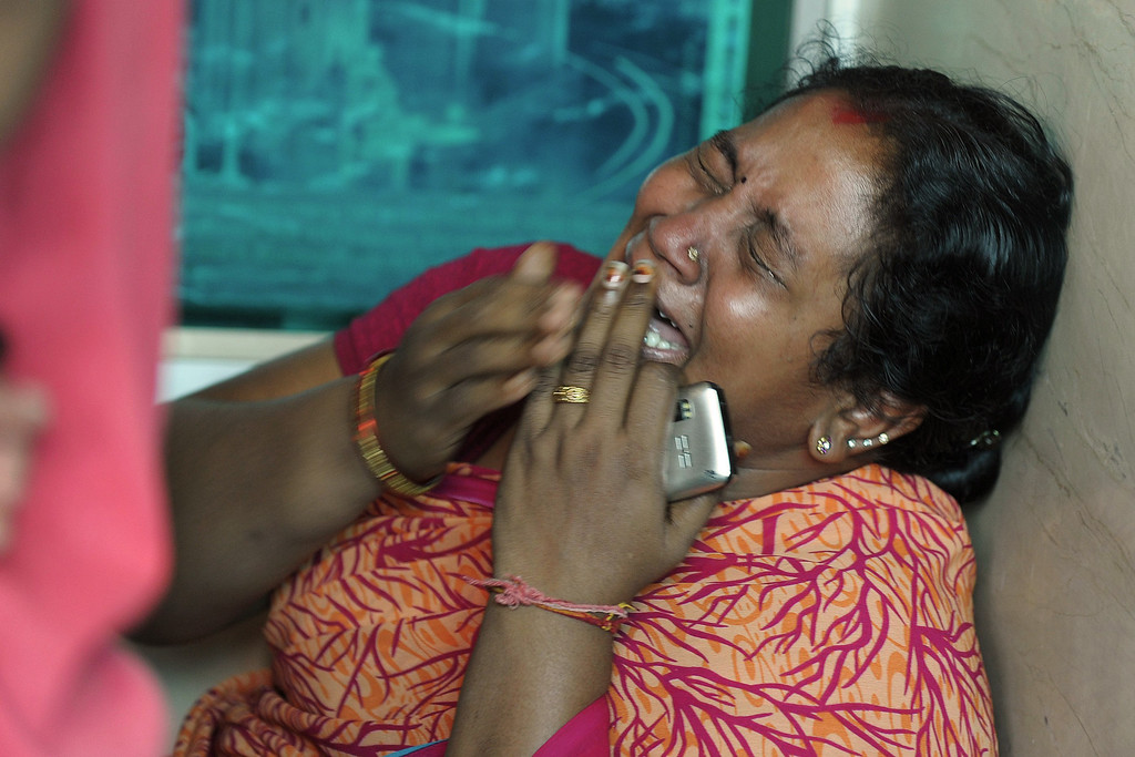 . A relative of a victim killed in a bus accident reacts after receiving news from police outside the private bus operator\'s office in Hyderabad on October 30, 2013. AFP PHOTO / Noah  SEELAM/AFP/Getty Images