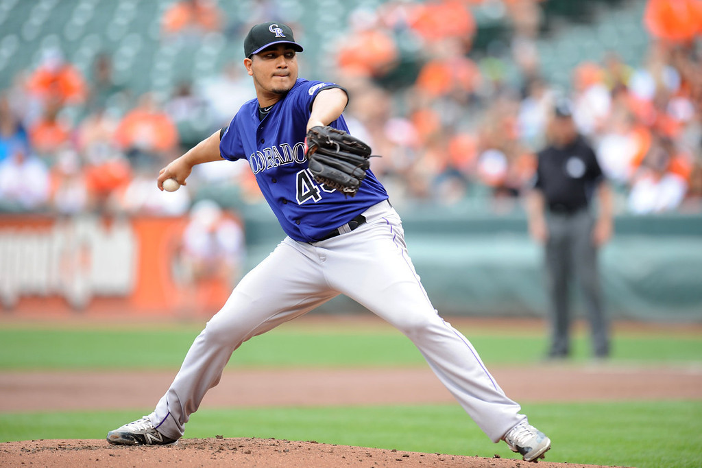 . Jhoulys Chacin #45 of the Colorado Rockies pitches during a baseball game against the Baltimore Orioles on August 18, 2013 at Oriole Park at Camden Yards in Baltimore, Maryland.  (Photo by Mitchell Layton/Getty Images)