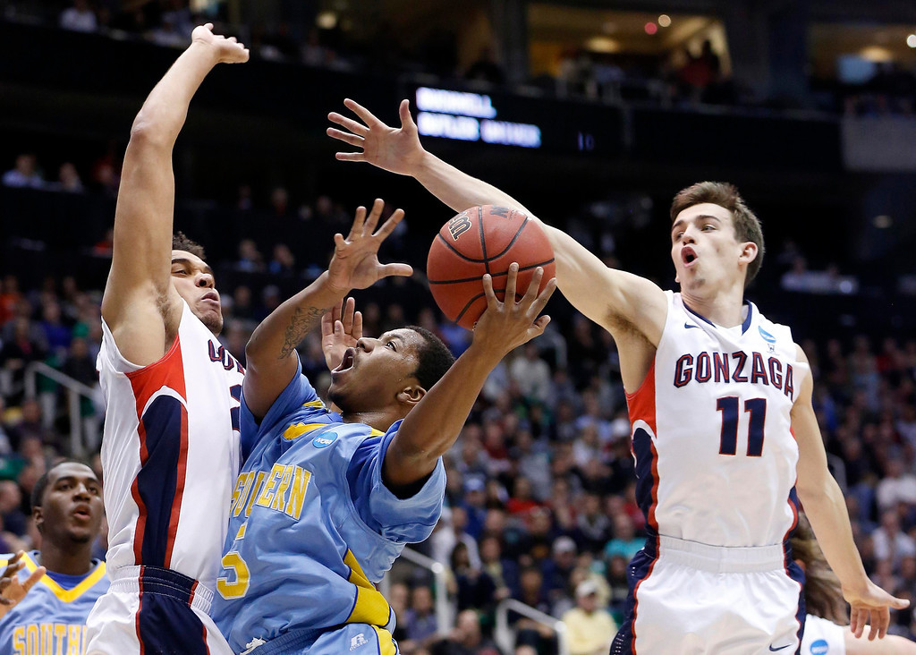 . Southern University guard Jameel Grace (5) attempts a shot while defended by Gonzaga forward Elias Harris (20) and guard David Stockton (11)during the first half of their second round NCAA tournament basketball game in Salt Lake City, Utah, March 21, 2013. REUTERS/Jim Urquhart