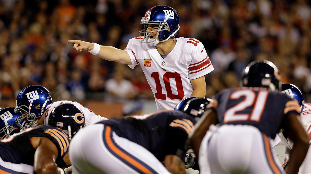 . New York Giants quarterback Eli Manning (10) calls a play against the Chicago Bears in the first half of an NFL football game on Thursday, Oct. 10, 2013, in Chicago. (AP Photo/Nam Y. Huh)