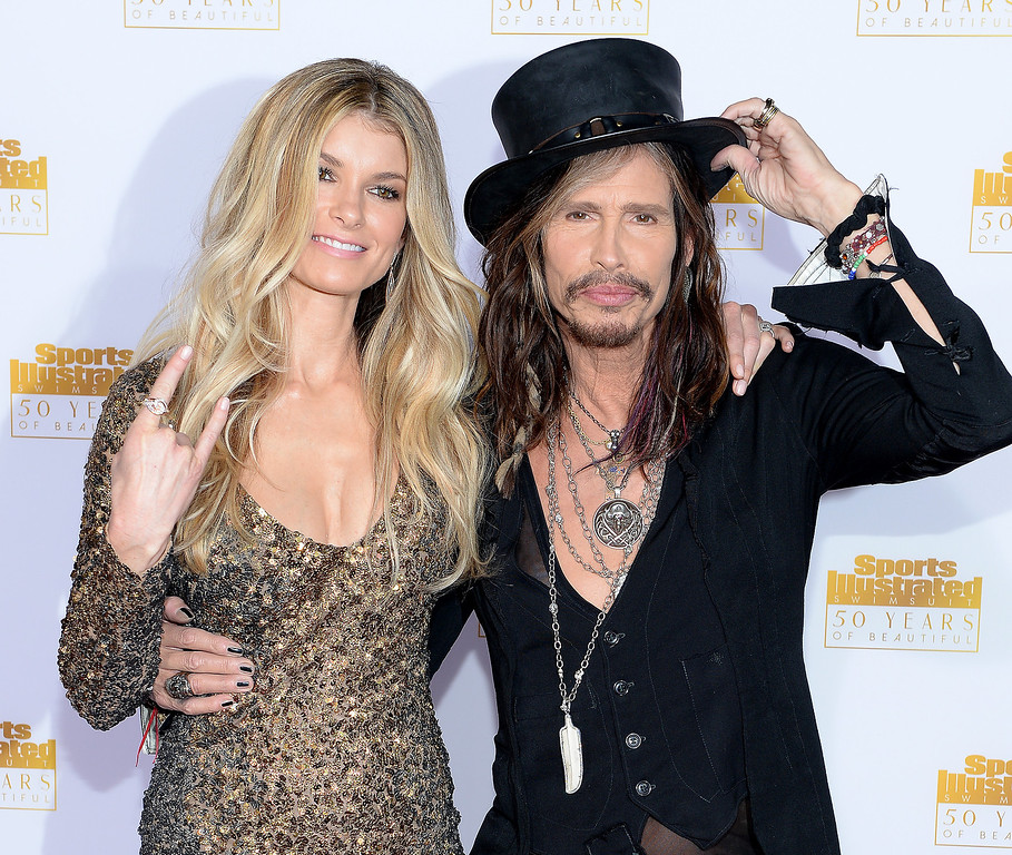 . Model Marisa Miller (L) and musician Steven Tyler of Aerosmith attends NBC and Time Inc. celebrate the 50th anniversary of the Sports Illustrated Swimsuit Issue at Dolby Theatre on January 14, 2014 in Hollywood, California.  (Photo by Dimitrios Kambouris/Getty Images)
