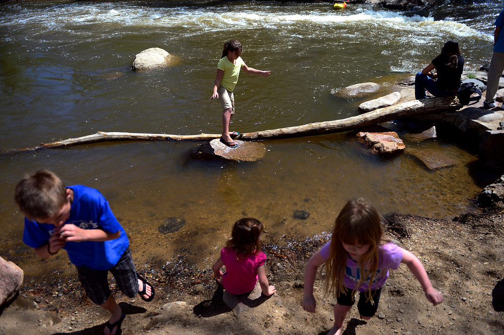 . Emma Ellison, 9, balances on a rock and a stick during Golden Games at the Clear Creek Whitewater Park. (Photo by AAron Ontiveroz/The Denver Post)