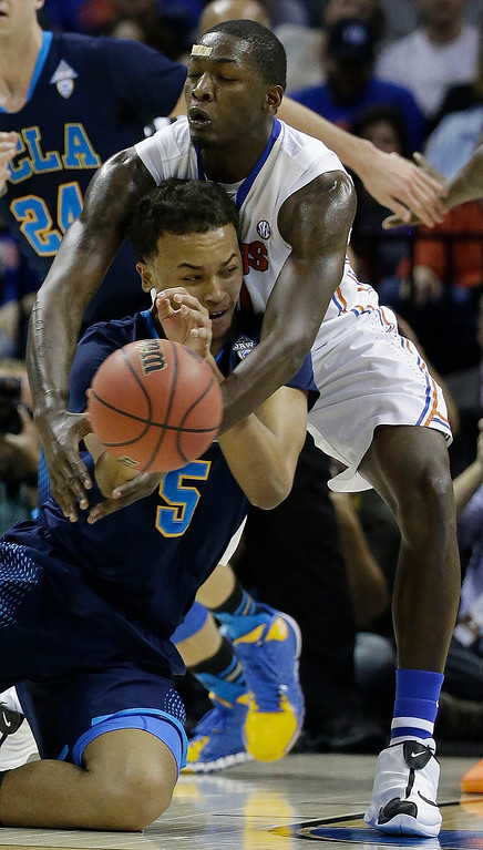 . UCLA guard/forward Kyle Anderson (5) works against Florida forward Dorian Finney-Smith (10) during the first half in a regional semifinal game at the NCAA college basketball tournament, Thursday, March 27, 2014, in Memphis, Tenn. (AP Photo/Mark Humphrey)