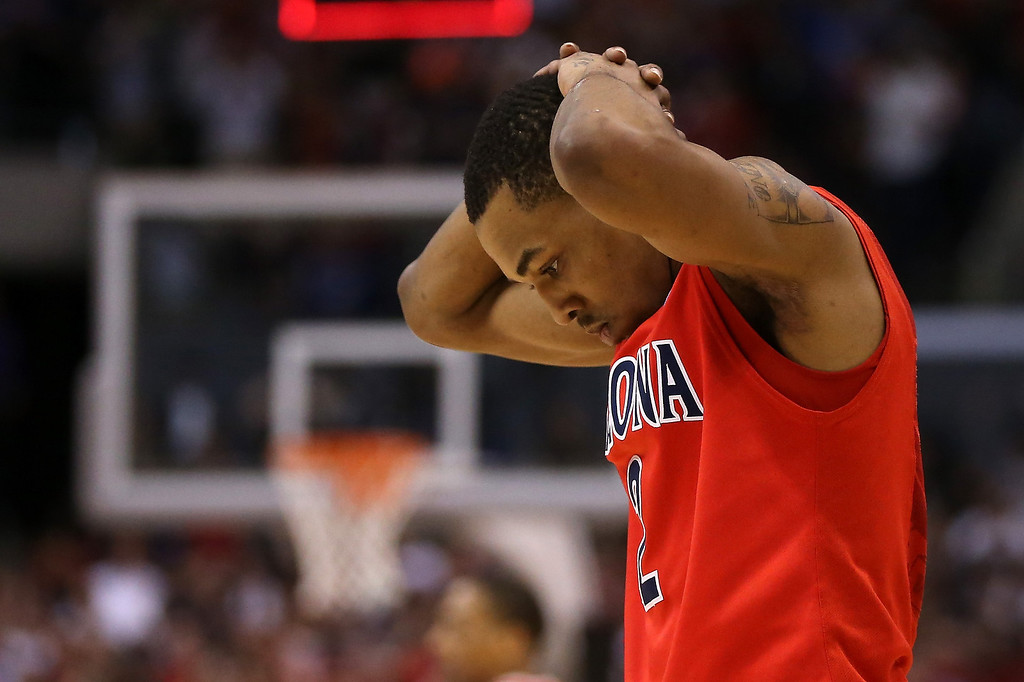 . Mark Lyons #2 of the Arizona Wildcats reacts as he walks off the court after losing to the Ohio State Buckeyes 73-70 during the West Regional of the 2013 NCAA Men\'s Basketball Tournament at Staples Center on March 28, 2013 in Los Angeles, California.  (Photo by Jeff Gross/Getty Images)
