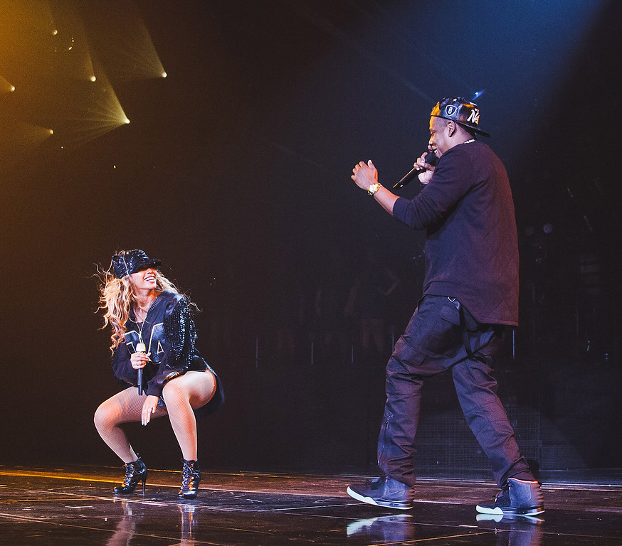 """. Jay Z, left,  joins his wife Beyonce onstage during Beyonce\'s \""""Mrs. Carter Show World Tour 2013\"""", on Monday, Aug. 5, 2013 at the Barclays Center in the Brooklyn borough of New York. (Photo by Robin Harper/Invision for Parkwood Entertainment/AP Images)"""