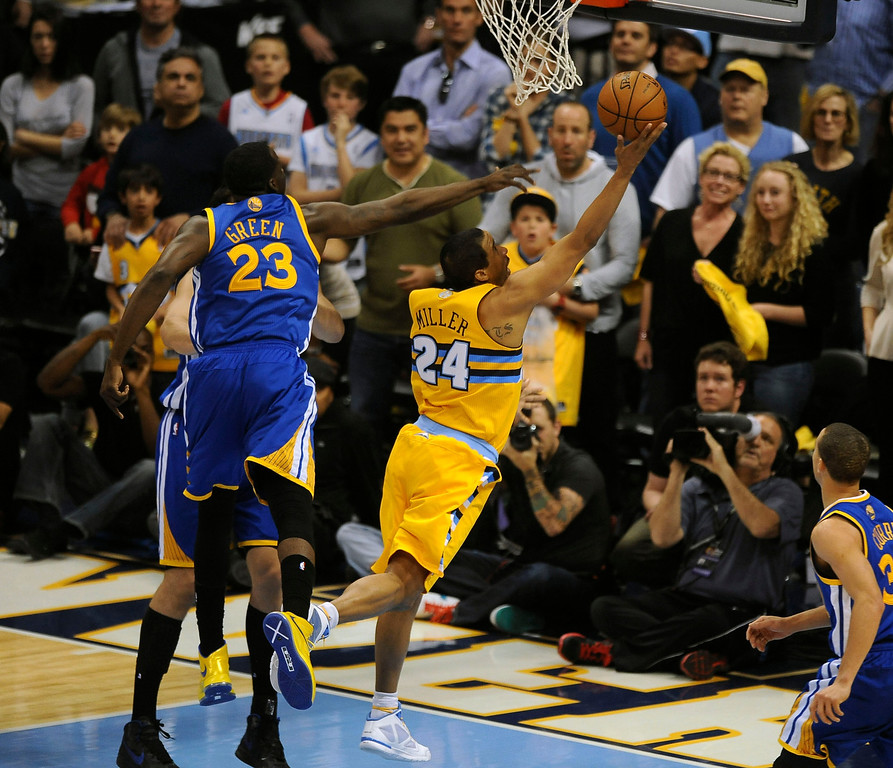 . DENVER, CO. - APRIL 20: Denver Nuggets guard Andre Miller (24) drives against Draymond Green (23) for the winning basket in the fourth quarter. The Denver Nuggets defeated the Golden State Warriors 97-95 in Game 1 of the Western Conference First Round Series at the Pepsi Center in Denver, Colo. on April 20, 2013. (Photo by Steve Nehf/The Denver Post)