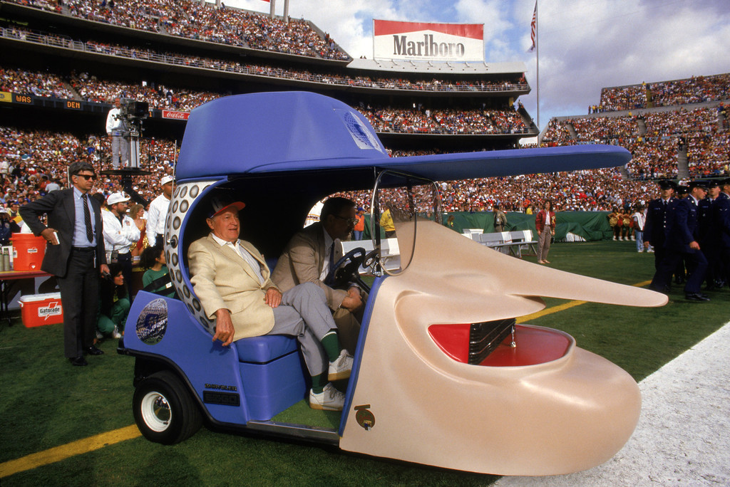 . Comedian Bob Hope gets driven onto the fiels with a cart resembling his likeness during Super Bowl XXII between the Washington Redskins and the Denver Broncos at Jack Murphy Stadium on January 31, 1988 in San Diego, California.    (Photo by George Rose/Getty Images)