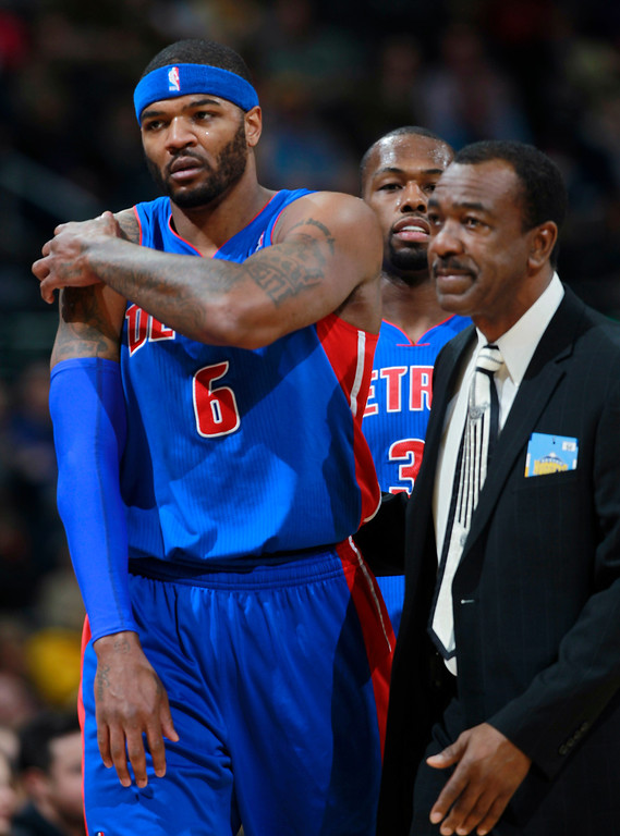 . Detroit Pistons forward Josh Smith, front left, is escorted from the court after being ejected by team official while guard Rodney Stuckey follows in the third quarter of the Denver Nuggets\' 118-109 victory over the Pistons in an NBA basketball game in Denver on Wednesday, March 19, 2014. (AP Photo/David Zalubowski)