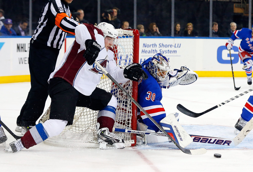 . Henrik Lundqvist #30 of the New York Rangers stops a third-period scoring attempt from Matt Duchene #9 of the Colorado Avalanche at Madison Square Garden on February 4, 2014 in New York City.  (Photo by Jim McIsaac/Getty Images)