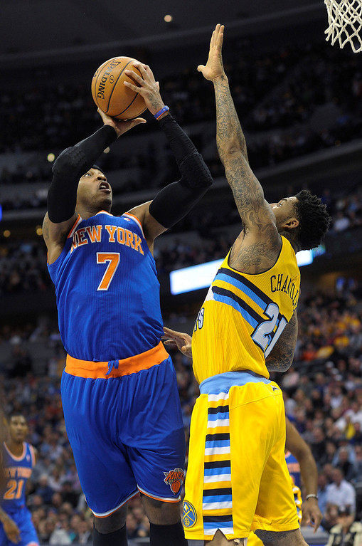 . Knicks forward Carmelo Anthony (7) put up a shot over Denver defender Wilson Chandler (21) in the first half.     Photo By Karl Gehring/The Denver Post