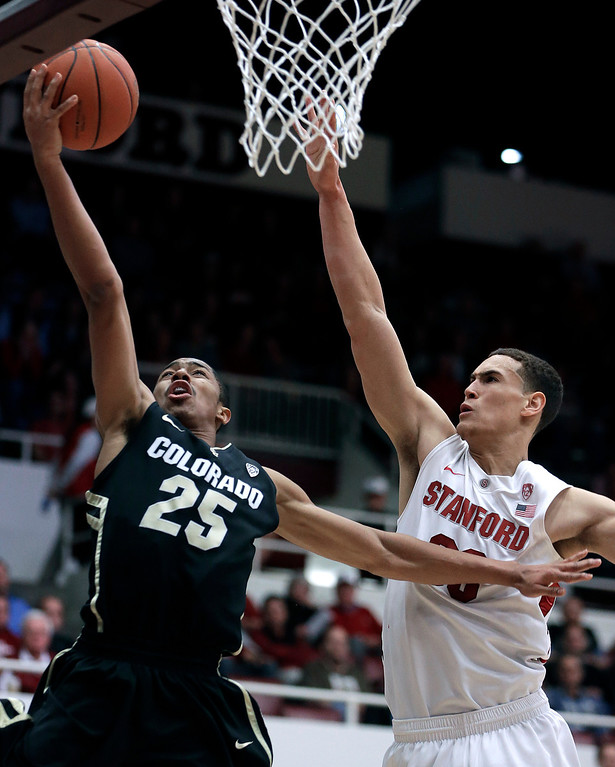 . Colorado\'s Spencer Dinwiddie (25) lays up a shot past Stanford\'s Dwight Powell, right, during the first half of an NCAA college basketball game Wednesday, Feb. 27, 2013, in Stanford, Calif. (AP Photo/Ben Margot)
