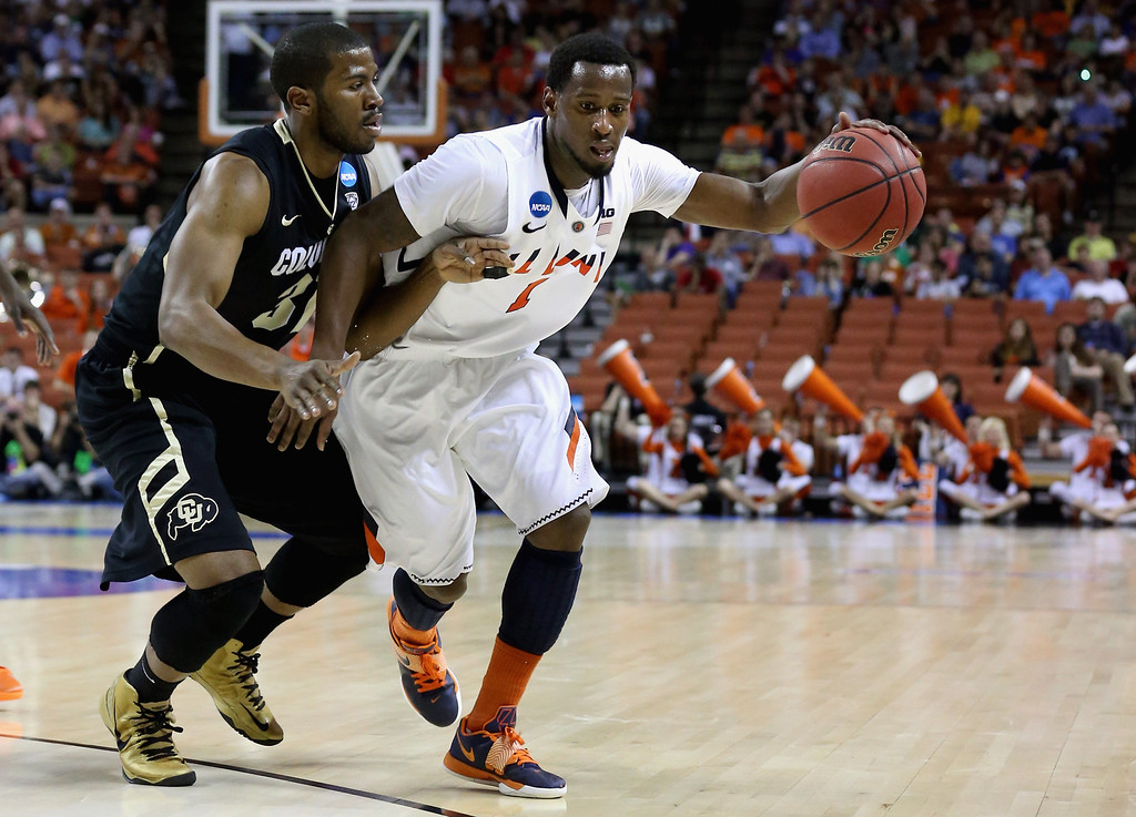 . AUSTIN, TX - MARCH 22:  D.J. Richardson #1 of the Illinois Fighting Illini dribbles past Jeremy Adams #31 of the Colorado Buffaloes during the second round of the 2013 NCAA Men\'s Basketball Tournament at The Frank Erwin Center on March 22, 2013 in Austin, Texas.  (Photo by Stephen Dunn/Getty Images)