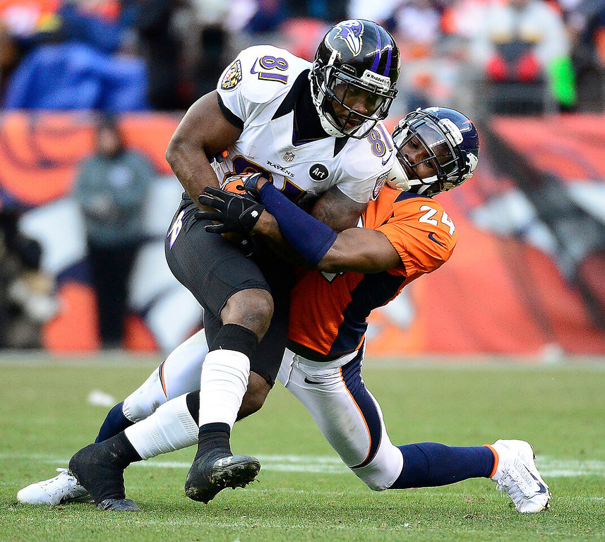 . Denver Broncos cornerback Champ Bailey (24) makes a tackle on Baltimore Ravens wide receiver Anquan Boldin (81) in the second quarter during the AFC Divisional playoff game at Sports Authority Field Saturday January 12, 2013. (Photo by AAron  Ontiveroz,/The Denver Post)