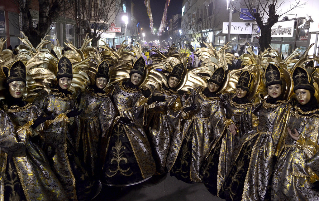 . Costumed revelers perform during the carnival procession in the southeastern Macedonia\'s town of Strumica, on Saturday, March 1, 2014. Some 2.500 disguised people participated Saturday, on the main carnival evening in Strumica. (AP Photo/Boris Grdanoski)