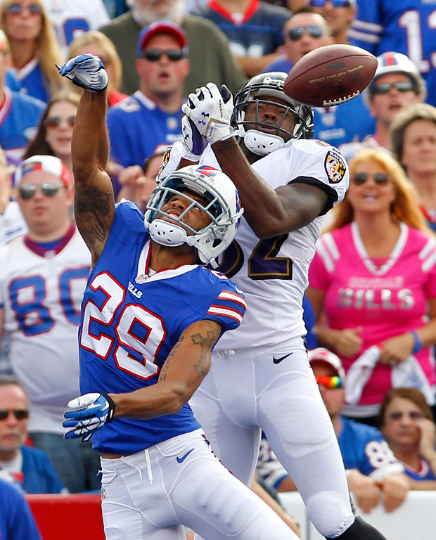 . Buffalo Bills defensive back Brandon Burton (29) breaks up a pass intended for Baltimore Ravens wide receiver Torrey Smith (82) during the second half of an NFL football game on Sunday, Sept. 29, 2013, in Orchard Park, N.Y. (AP Photo/Bill Wippert)