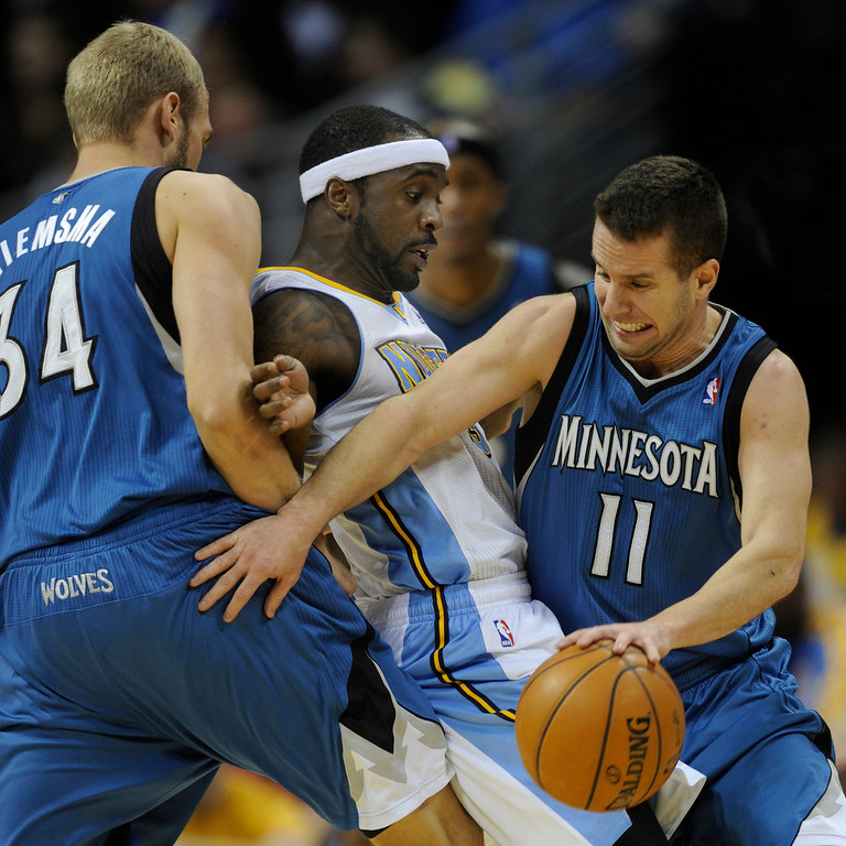 . Denver guard Ty Lawson (3) got caught between Wolves center Greg Stiemsma (34) and guard Jose Berea (11) in the second half. The Minnesota Timberwolves took a bite out of the Denver Nuggets winning 101-97 at the Pepsi Center Thursday night, January 3, 2013. Karl Gehring/The Denver Post