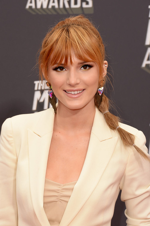. Actress Bella Thorne arrives at the 2013 MTV Movie Awards at Sony Pictures Studios on April 14, 2013 in Culver City, California.  (Photo by Jason Merritt/Getty Images)