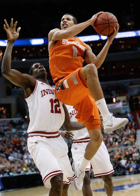 . Syracuse guard Michael Carter-Williams (1) goes up past Indiana forward Hanner Mosquera-Perea (12) during the second half of an East Regional semifinal in the NCAA men\'s college basketball tournament, Thursday, March 28, 2013, in Washington. (AP Photo/Pablo Martinez Monsivais)