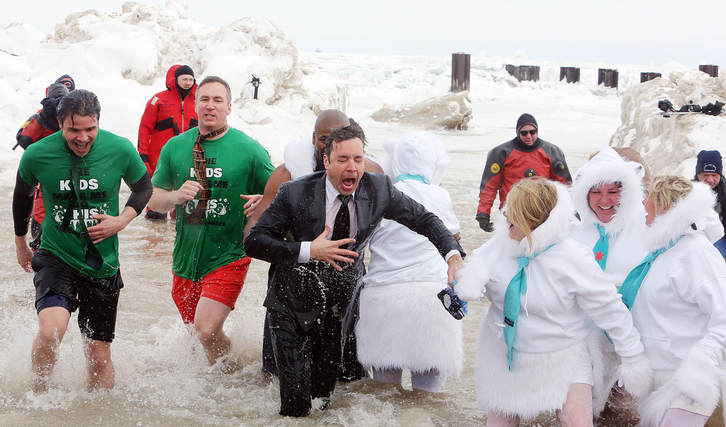 . CHICAGO, IL - MARCH 02: Jimmy Fallon and Israel Idonije participates in the Chicago Polar Plunge 2014 at North Avenue Beach on March 2, 2014 in Chicago, Illinois. (Photo by Tasos Katopodis/Getty Images)