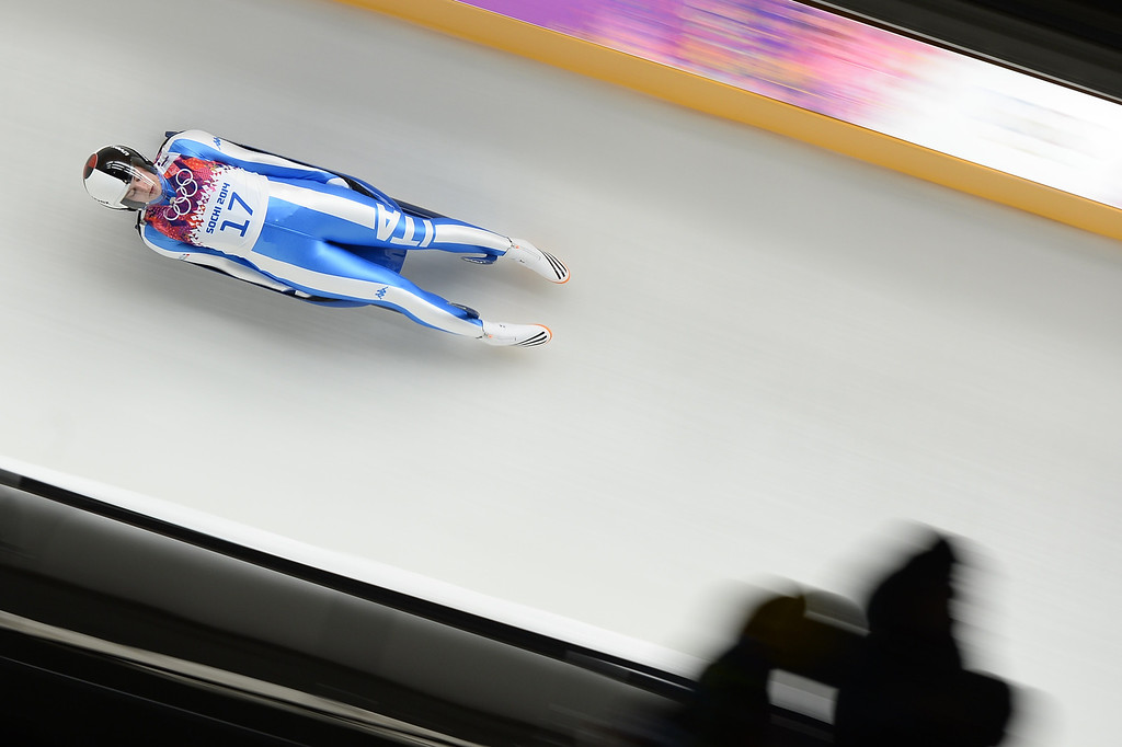 . Italy\'s Andrea Voetter competes during the Women\'s Luge Singles run one at the Sliding Center Sanki during the Sochi Winter Olympics on February 10, 2014.   AFP PHOTO / LIONEL BONAVENTURE/AFP/Getty Images