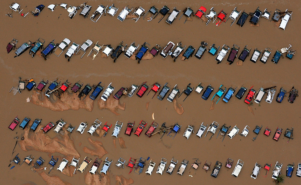 . A junkyard on East 37th Street and First Avenue in Evans, Colo., sits in rising floodwater from the South Platte River.
