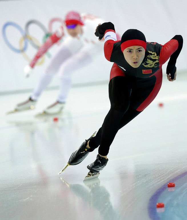 . China\'s Wang Beixing, right, and Russia\'s Olga Fatkulina compete in the first heat of the women\'s 500-meter speed skating race at the Adler Arena Skating Center during the 2014 Winter Olympics, Tuesday, Feb. 11, 2014, in Sochi, Russia. (AP Photo/Matt Dunham)