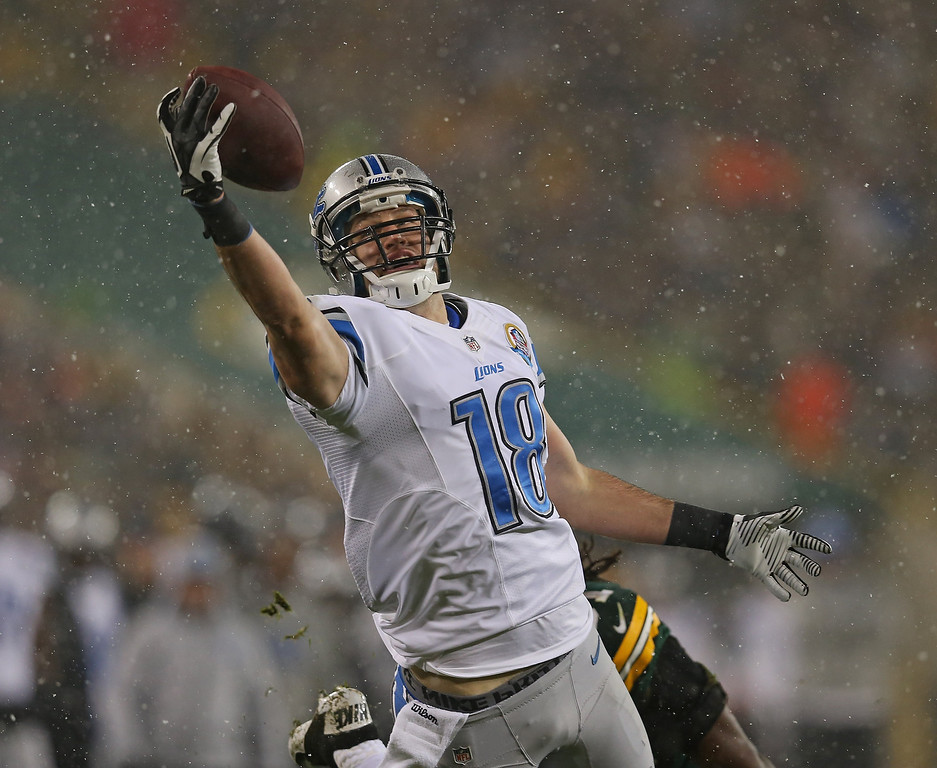 . GREEN BAY, WI - DECEMBER 09:  Kris Durham #18 of the Detroit Lions makes a one-handed catch for a long gain against the Green Bay Packers at Lambeau Field on December 9, 2012 in Green Bay, Wisconsin.  (Photo by Jonathan Daniel/Getty Images)