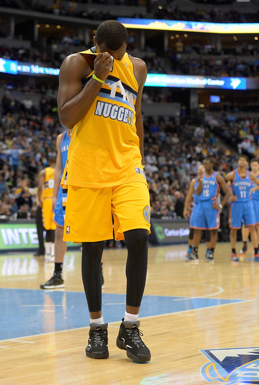 . Denver Nuggets small forward Jordan Hamilton (1) wipes his forehead as he walks off the court after getting ejected from the game against the Oklahoma City Thunder December 17, 2013 at Pepsi Center. (Photo by John Leyba/The Denver Post)