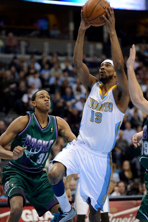 . DENVER, CO. - FEBRUARY 05: Corey Brewer (13) of the Denver Nuggets drives on John Henson (31) of the Milwaukee Bucks for a basket during the first quarter February 05, 2013 at Pepsi Center. The Denver Nuggets take on the Milwaukee Bucks in NBA action. (Photo By John Leyba/The Denver Post)