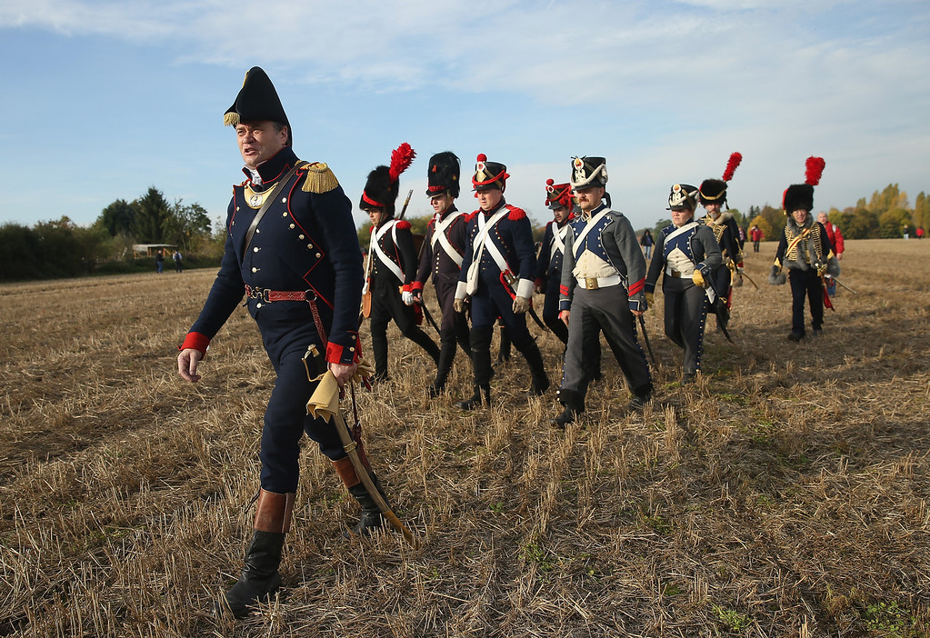 . A historical society enthusiast in the role of a lieutenant leads French soldiers fighting under Napoleon arrive to re-enact The Battle of Nations on its 200th anniverary on October 20, 2013 near Leipzig, Germany.   (Photo by Sean Gallup/Getty Images)